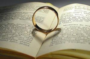 Wedding band on book of verses and blessings