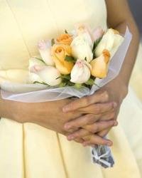 Bridesmaid with yellow and white spring tulips