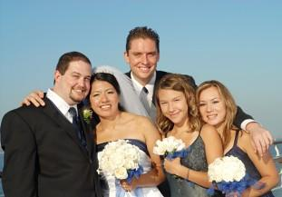 Bride, groom, bridesmaids and a male bridesmaid/attendant