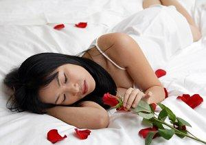 Bride on a bed strewn with rose petals