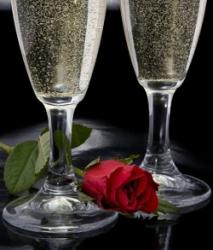 Two glasses of Champagne and a rose