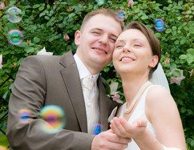 Couple enjoying bubbles at their second wedding