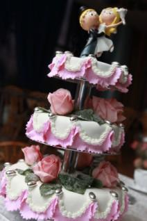 Whimsical wedding cake with cute couple topper