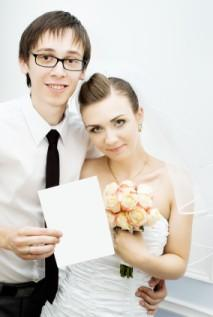 bride and groom holding card