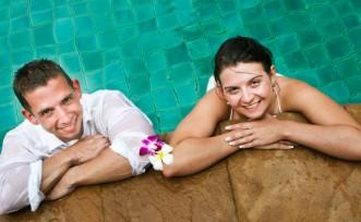 newlyweds in swimming pool