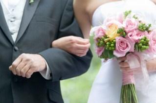father escorting bride down aisle