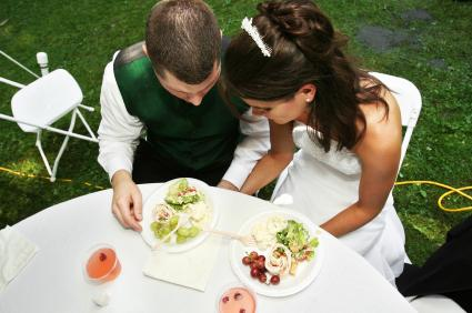 Bride And Groom With Plates Of Food
