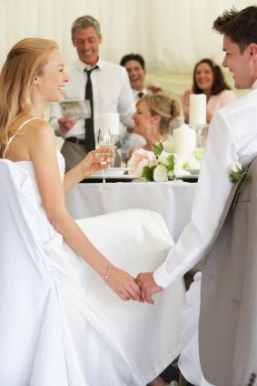 couple laughing at best man's speech