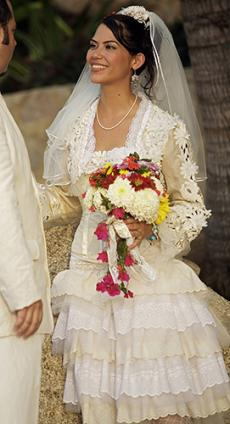 Bride in church-influenced wedding dress