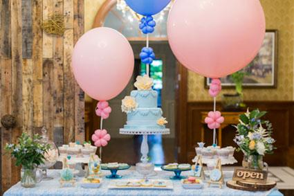 cake table with pink balloons