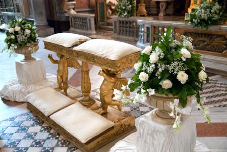 Wedding altar with urn flower arrangements