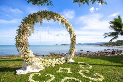 Floral wedding sculpture by sea