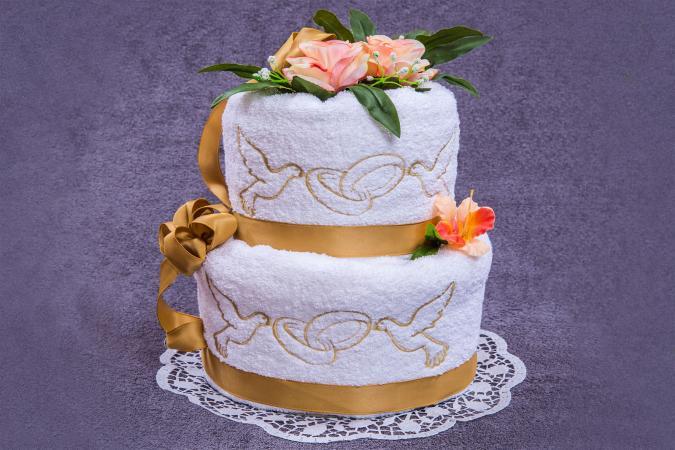 Towel wedding cake on purple background