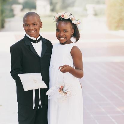 children participating in weddin