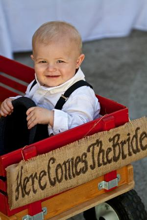 ittle boy in wagon at wedding
