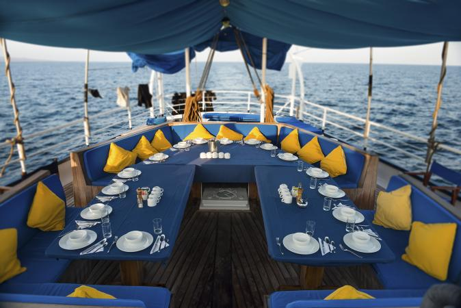 large dinner table set on yacht
