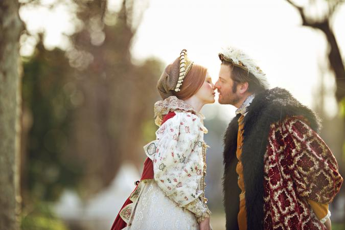 Renaissance wedding bride and groom kissing