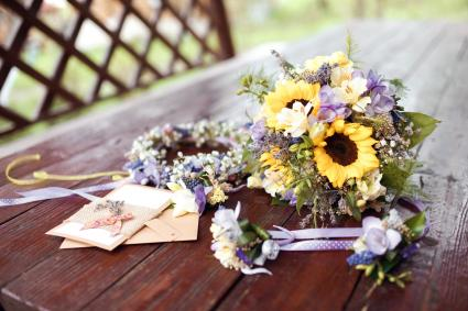 wedding bouquet, wreath and invitations at daylight