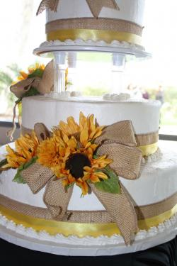 Sunflowers with burlap bow cake decoration