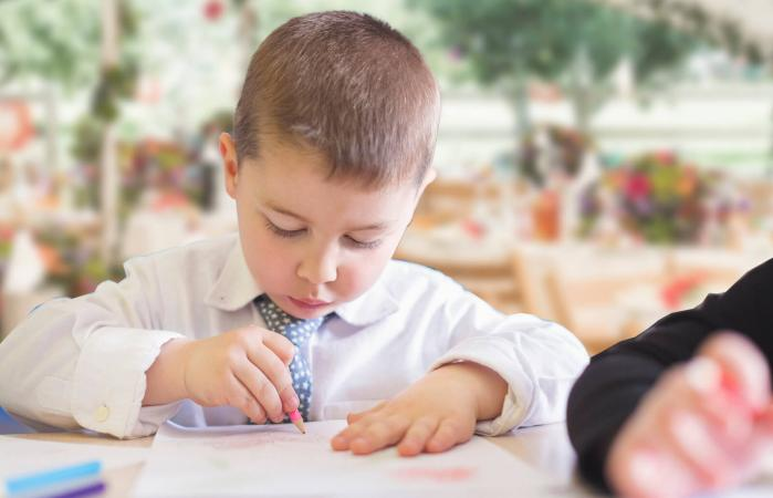 child coloring at wedding