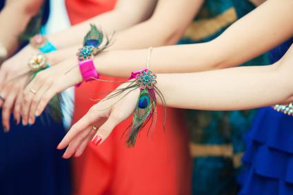 Hands of bridesmaids with bracelets