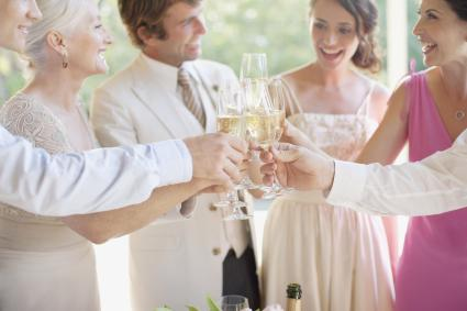 Family toasting with champagne at wedding reception