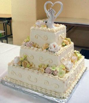 Wedding cake decorated with magnolias