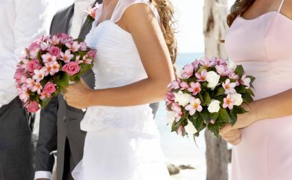 Bride and Bridesmaid holding beautiful frangipani bouquets