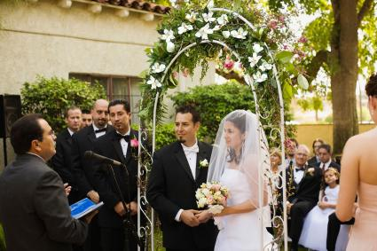 Wedding arch with magnolias and greenery