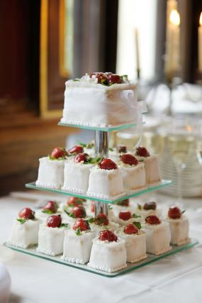 Individual white square wedding cakes