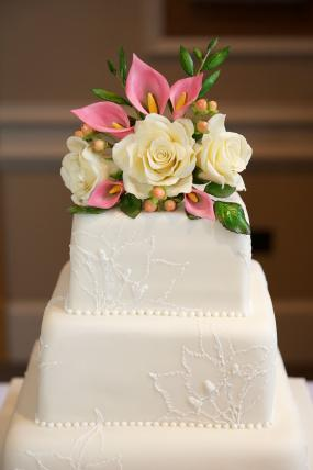 Embroidered floral style square wedding cake