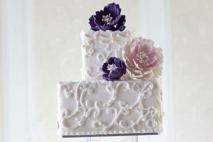 square wedding cake with scroll pattern