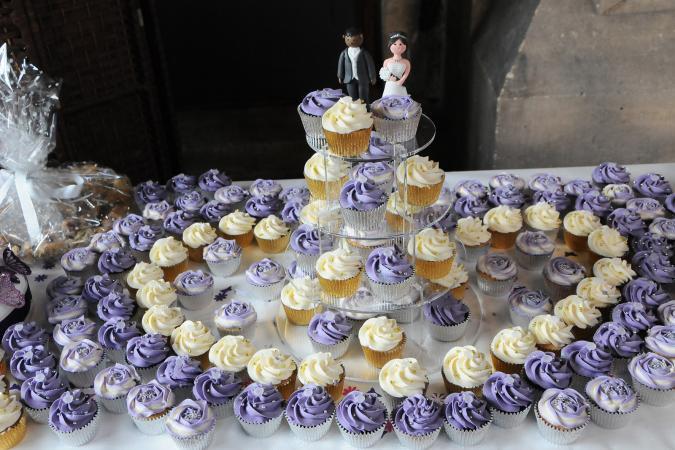 purple and white wedding cupcake display