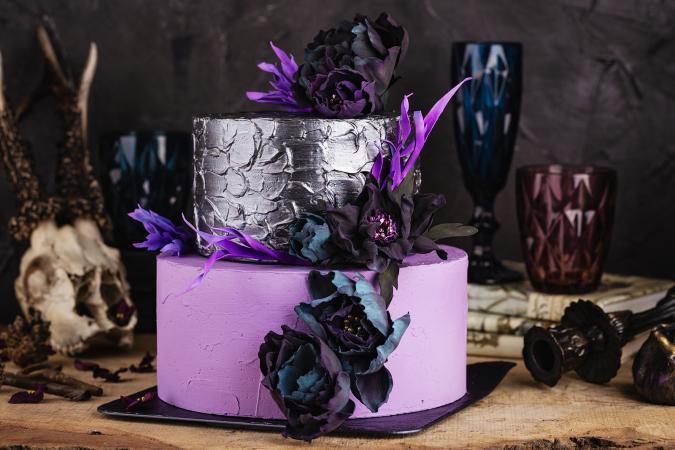 Purple wedding cake with black flowers