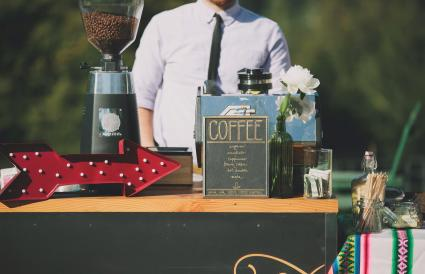 wedding barista behind coffee bar