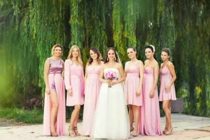 Bride with bridesmaids in pink dresses