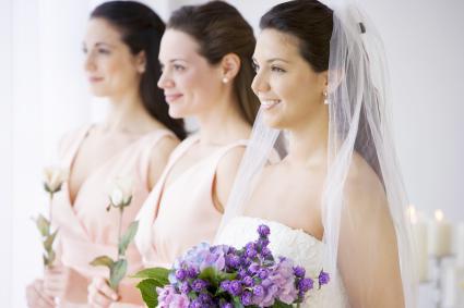 Bride and bridesmaids in row