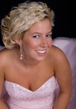 Bride in a blush pink wedding dress