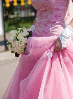 Bride wearing a bold pink wedding dress