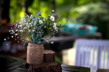 Twine vase with wild flowers