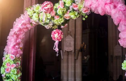 pink arch by church doors