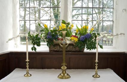 Flowers and candles in front of a window