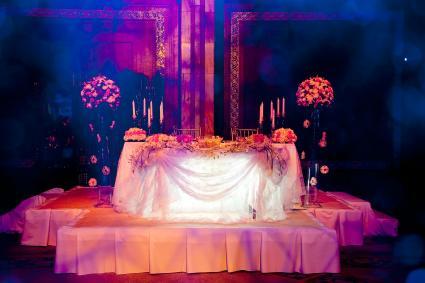 Lavish bride and groom table at reception