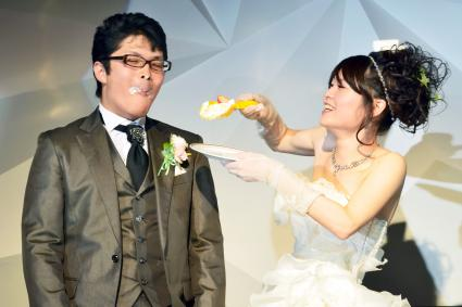bride getting cake on groom's face