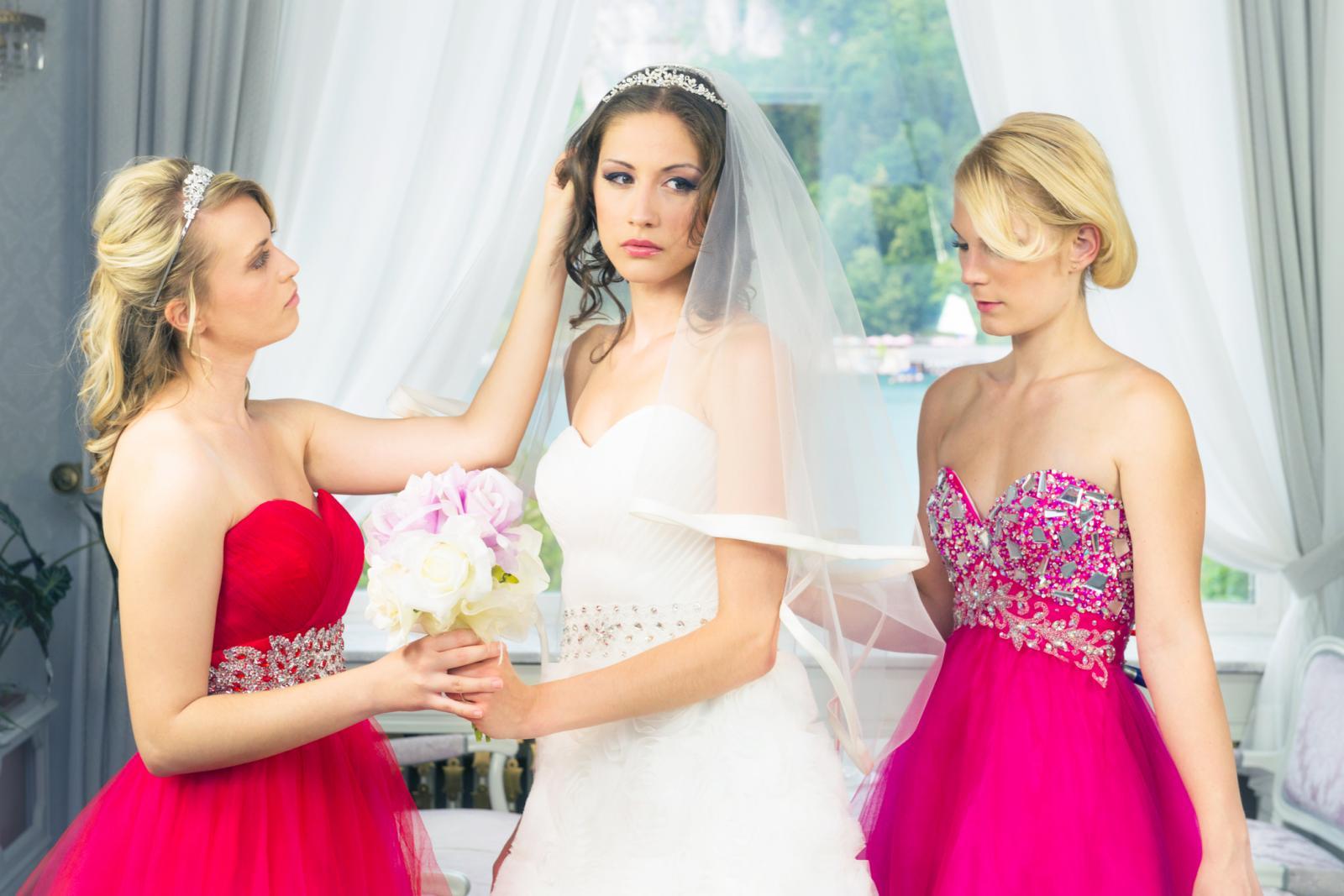 bridesmaids with unhappy bride