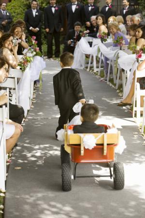 pulling ring bearer in wedding wagon