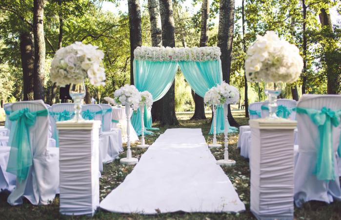 tulle on chairs and wedding arch