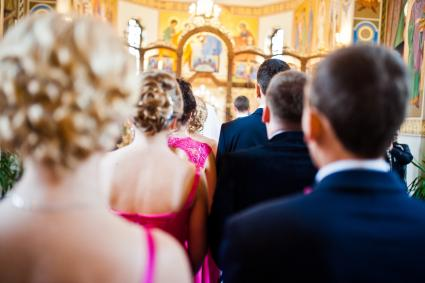 Stylish groomsmen and bridesmaids at the church