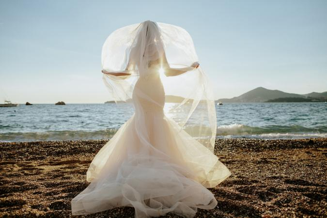 Bride standing on beach