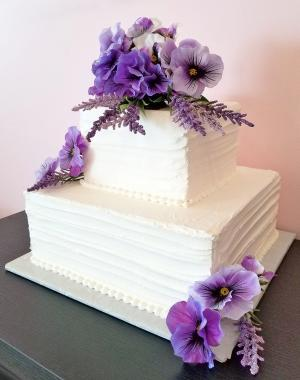pansy bouquet on tiered square cake